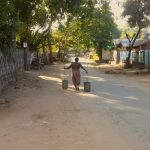 lady carrying water from the town well