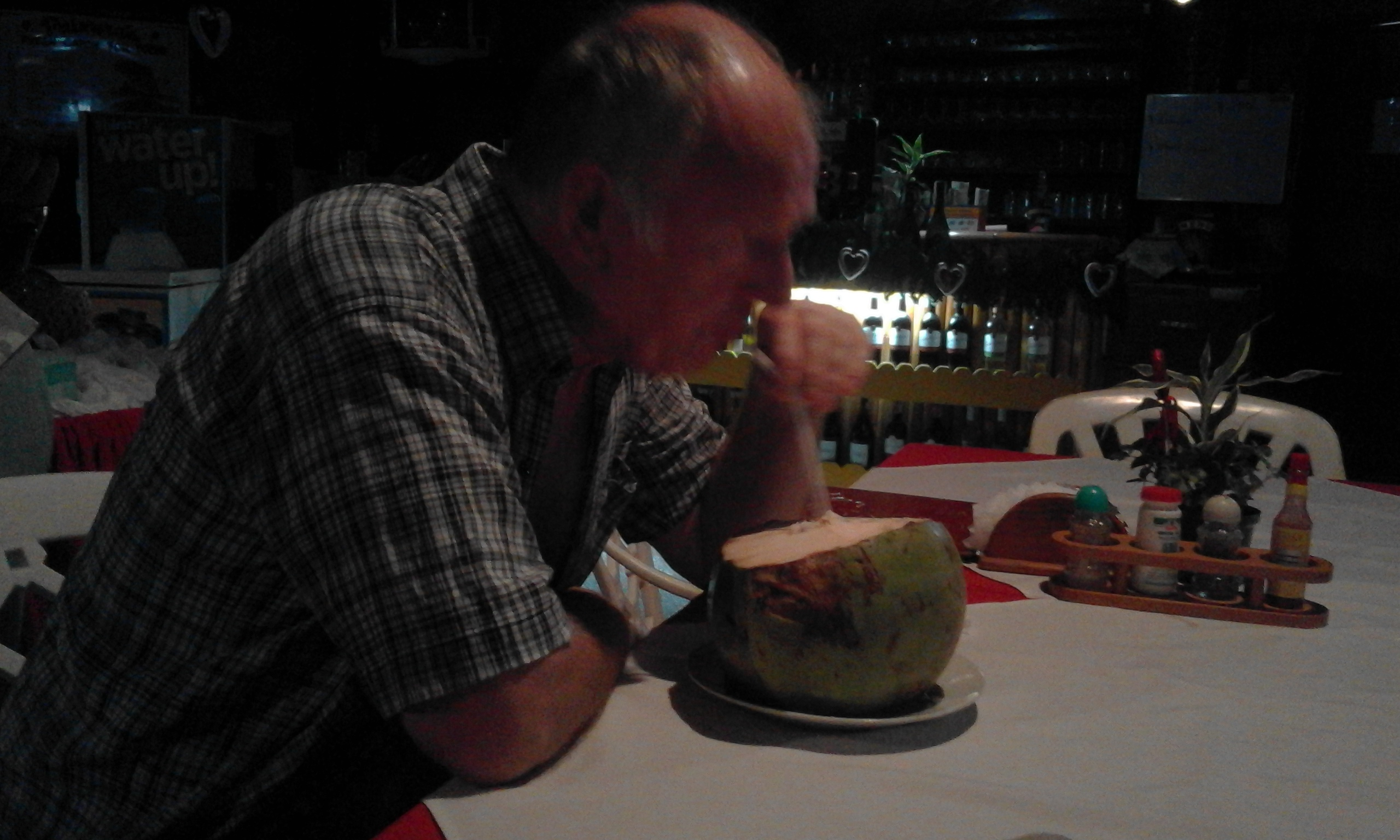 Dad's first taste of a fresh coconut :)